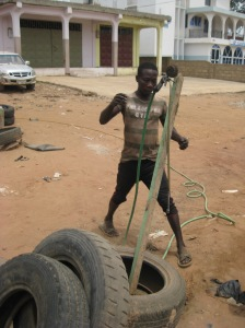 A galvanizer hurrying to inflate the taxi's tires